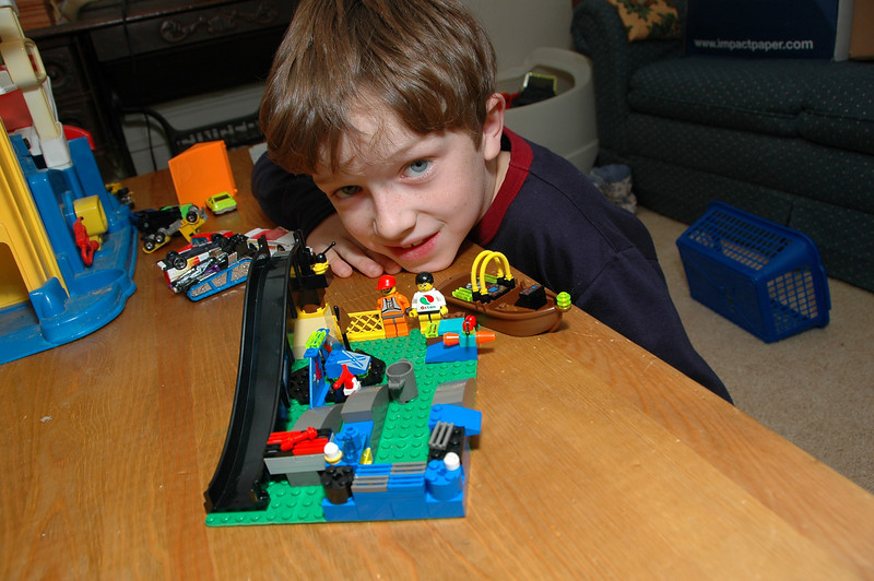Zac displays 2 of his Lego creations -- a boat and a multi-purpose room.
