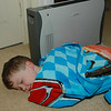 Joshua found a warm comfortable place for a nap -- right beside a space heater. Sort of reminds me of how most cats will find a warm spot for taking naps. If Joshua were a cat, he probably would be purring very loudly.
