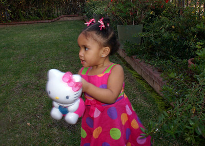 Trying to get her Hello Kitty to make bubbles.