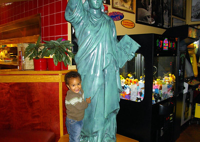 Isaiah with the Statue of Liberty at the Red Robbin Restaurant.