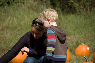 Annie and Jackson observing the pumpkins