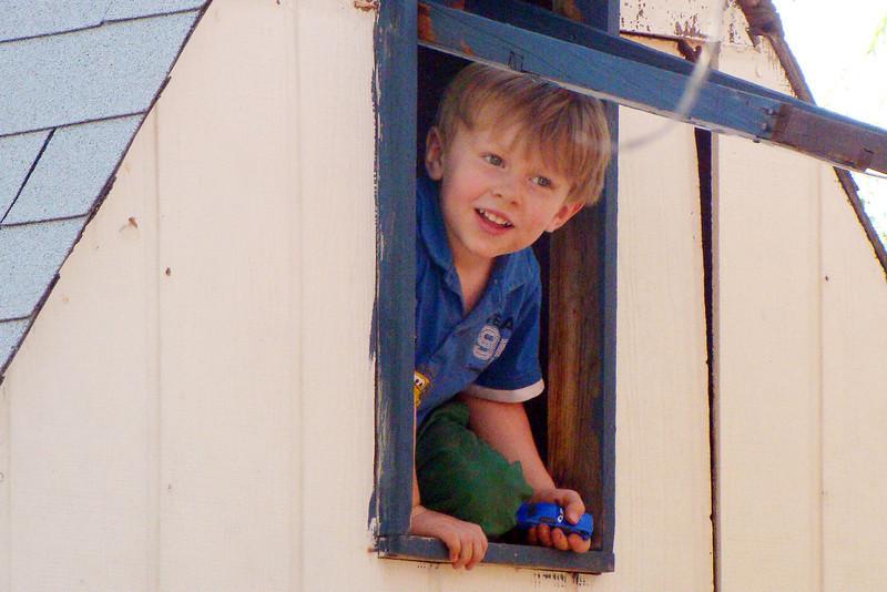 April - enjoying the backyard playhouse