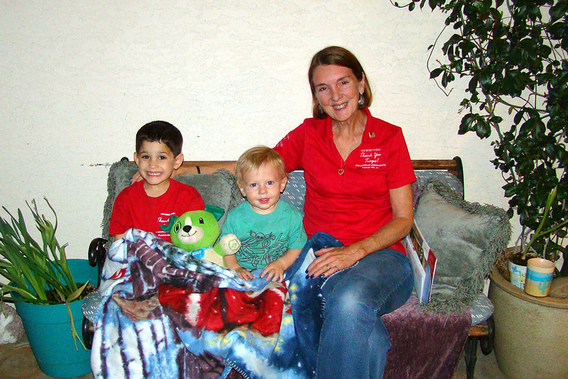 "April - with cousin Gabe and ""Grandma"" Judi"