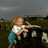 She found out that it was no easy task to climb the big tire.