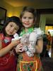 Cousins in aprons w/stuffed friends--recognize the snow leopard Douglas?
