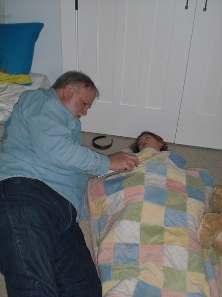 Grandpa Bill reading Beija a bedtime story--she wanted to sleep downstairs with us...