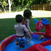 Slade and Kamryn working together to empty the pool at Creekside Dr.