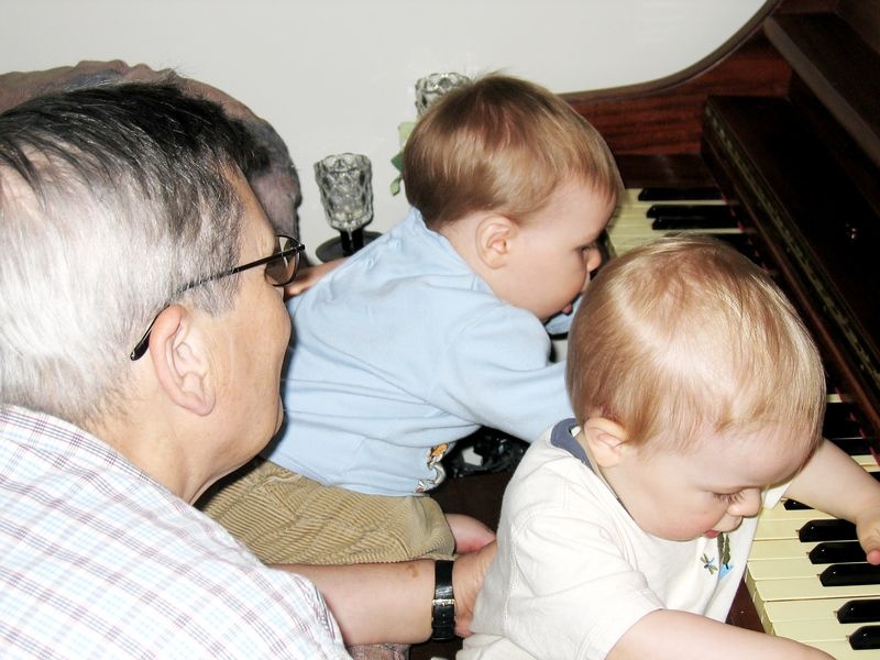Adrian & Cameron First piano lesson with Papa Jean Roger looking on
