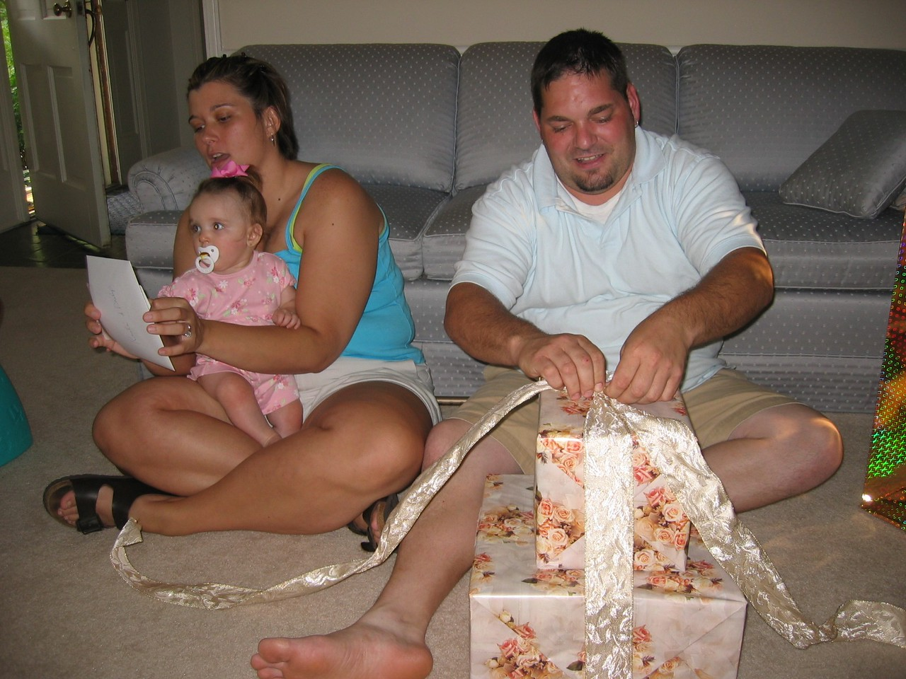 Opening Susie, Bugsie, Cara &  Grant's Wedding Gift!!   We just love the ribbon!!!
