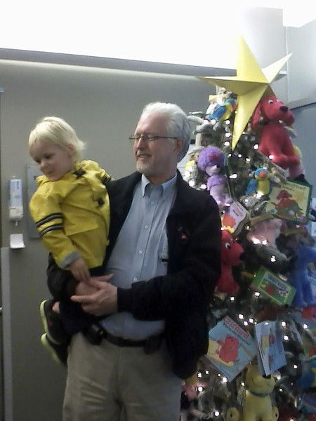I took Tristen over to the Children's Center to see the tree and doghouse.  He had fun running around in it, of course!