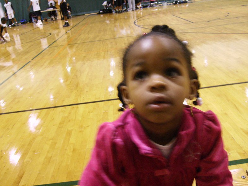 I'm at my Daddy's basketball game. As you can see, I'm not impressed, I'm looking in the opposite direction.