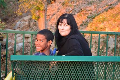 Noah and Grandma on the bench near the bridge.