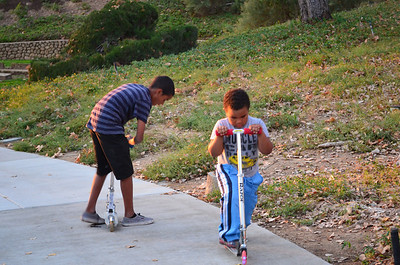 The boys skating on the trail at East Highlands Ranch.