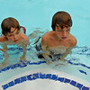 Joshua and Zac take to swimming just as naturally as a duck takes to water.