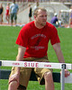 Granite City High School track coach Miller watches as his triple jumpers compete at the 2007 SIUE track meet.