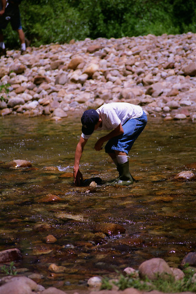Jason spots a big rock for the Dam