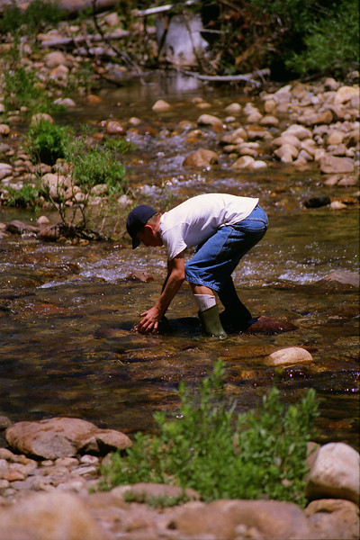 Jason lifts his rock for the Dam out of the Creek