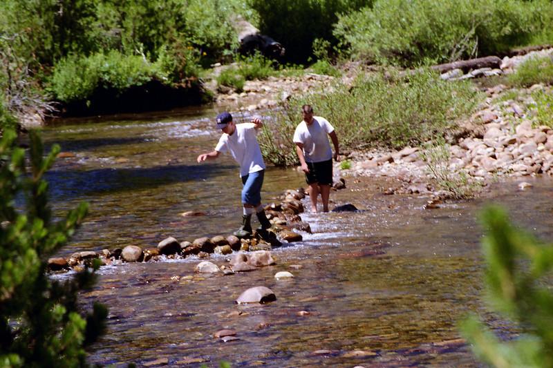 Jason walks along the Dam with Damn-Good Balance, Brian takes the Creek