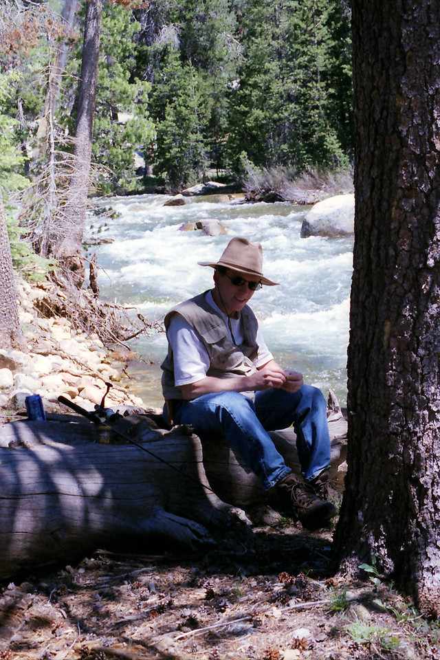 David takes refuge in the shade while setting his pole up on the West side of the Creek