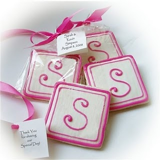 Monogrammed sugar cookies. Pictured in individual packaging for wedding favors.
