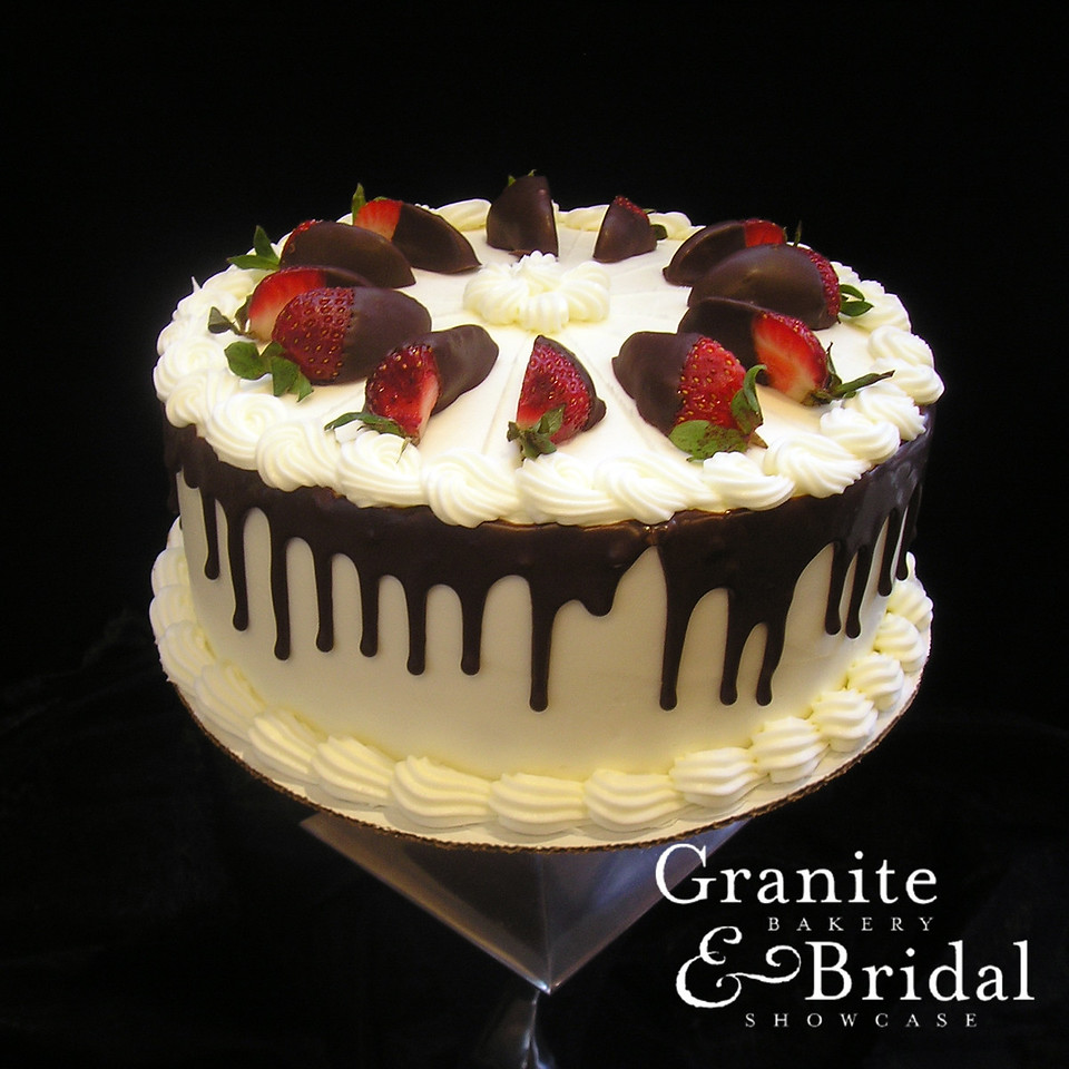 Strawberry & Cream Cheese - Strawberry Swirl cake with strawberry and cream cheese. Covered in cream cheese icing with fudge drips and topped with chocolate dipped strawberry slices.