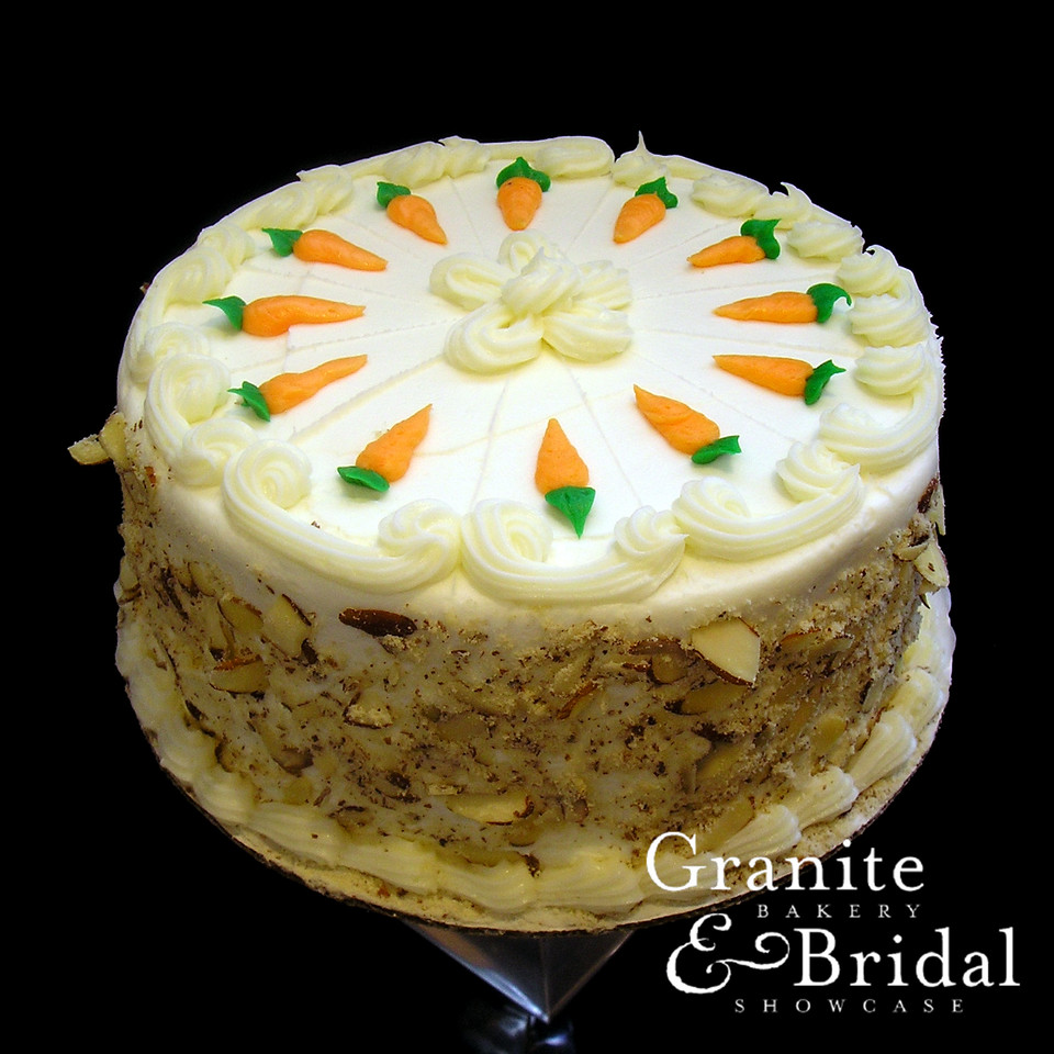 Carrot & Cream Cheese - Carrot cake with cream cheese filling and frosting. Sides coated in sliced almonds.