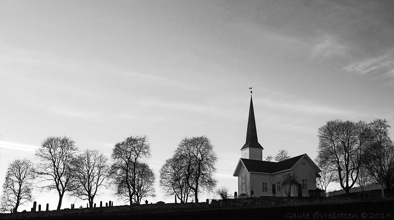 Solnedgang ved Nes kirke.<br /> The church at Nes in calm late winter sunset.