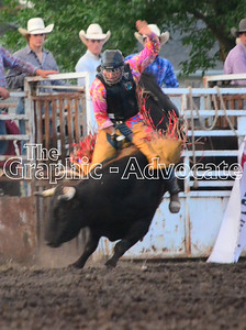 A bull rider tries to hold on during the 2016 Calhoun County Expo rodeo Friday night. GRAPHIC-ADVOCATE PHOTO/ERIN SOMMERS