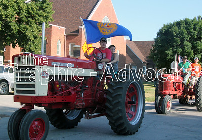 FFA members ride tractors during the 2016 Calhoun County Expo Parade in Rockwell City Wednesday. GRAPHIC-ADVOCATE PHOTO/ERIN SOMMERS