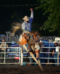 A bronco stays mounted during the Calhoun County Expo rodeo Friday night. GRAPHIC-ADVOCATE PHOTO/ERIN SOMMERS