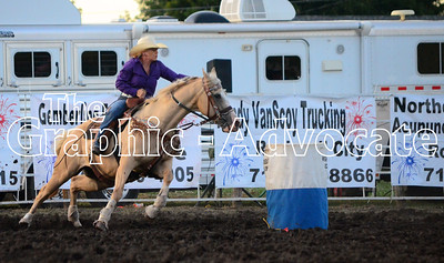 A barrel rider comes around a barrel during the 2016 Calhoun County Expo rodeo Friday night. GRAPHIC-ADVOCATE PHOTO/ERIN SOMMERS