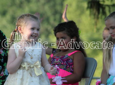 Little MIss Contestant Ella Cline spins and laughs while answering questions during the contest Wednesday evening. GRAPHIC-ADVOCATE PHOTO/ERIN SOMMERS