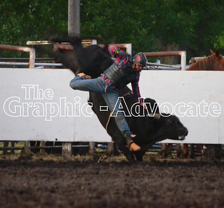 A bull rider falls to the ground during the rodeo at the 2016 Calhoun County Expo. GRAPHIC-ADVOCATE PHOTO/ERIN SOMMERS