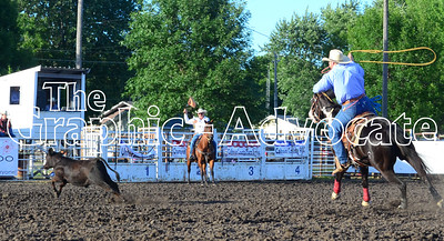 A rider aims to rope a calf during Friday's rodeo. GRAPHIC-ADVOCATE PHOTO/ERIN SOMMERS