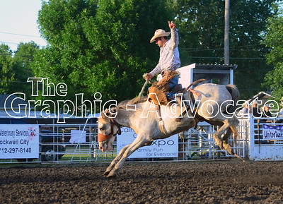A bronco rider throws up a hand for balance during Friday's rodeo. GRAPHIC-ADVOCATE PHOTO/ERIN SOMMERS