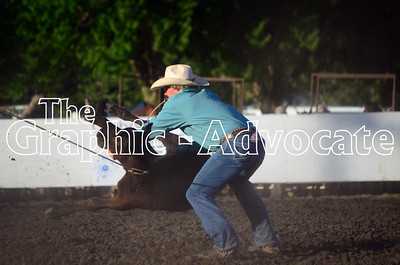 A cowboy begins the process of tying a calf during the calf roping competition. GRAPHIC-ADVOCATE PHOTO/ERIN SOMMERS