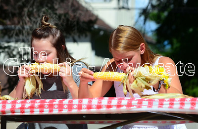 Two teenagers compete in the 13-18 year-old division of the sweet corn eating contest at Rockwell City's Sweet Corn Daze Saturday. GRAPHIC-ADVOCATE PHOTO/ERIN SOMMERS