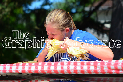 The winner of the sweet corn eating contest's 13-18 year-old division makes her way through her first ear of corn. GRAPHIC-ADVOCATE PHOTO/ERIN SOMMERS