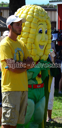Captain Corn watches the sweet corn eating contest Saturday. GRAPHIC-ADVOCATE PHOTO/ERIN SOMMERS