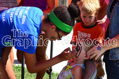 Members of the South Central Calhoun Dance Team painted faces at Sweet Corn Daze Saturday in Rockwell City. GRAPHIC-ADVOCATE PHOTO/ERIN SOMMERS