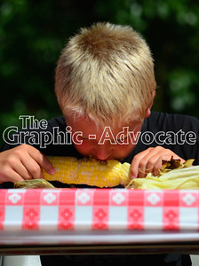 A boy tests his sweet corn eating technique during a contest at Saturday's Sweet Corn Daze in Rockwell City. GRAPHIC-ADVOCATE PHOTO/ERIN SOMMERS