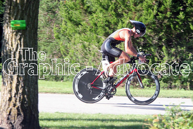 One of the first cyclists returns to Twin Lakes State Park during the Twin Lakes Triathlon Saturday morning. GRAPHIC-ADVOCATE PHOTO/ERIN SOMMERS