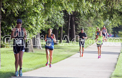 Runners head on out on the final leg of the Twin Lakes Triathlon Saturday morning. GRAPHIC-ADVOCATE PHOTO/ERIN SOMMERS