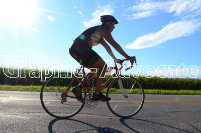 A cyclist heads down the road during the Twin Lakes Triathlon Saturday morning. GRAPHIC-ADVOCATE PHOTO/ERIN SOMMERS