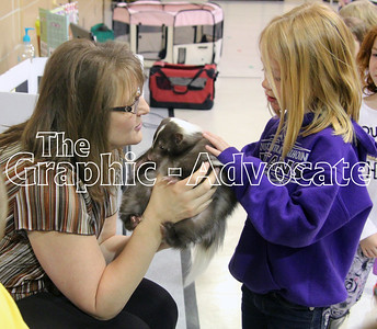 "Author Tina Wagner helps a South Central Calhoun Elementary School student pet a skunk April 6. Wagner read her book, ""Who Peed on the Floor?"" to the students and talked about the virtues of skunks as pets. GRAPHIC-ADVOCATE PHOTO/ERIN SOMMERS"