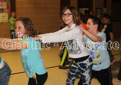 South Central Calhoun Elementary School students formed a Conga line during a dance party Thursday celebrating the school's high Iowa Assessment scores. GRAPHIC-ADVOCATE PHOTO/ERIN SOMMERS