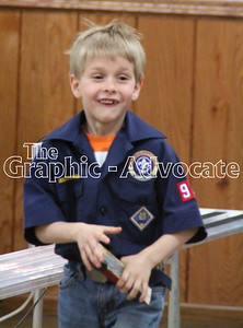 Cub Scout Max Henry reacts to a race during the annual Pinewood Derby Sunday afternoon. GRAPHIC-ADVOCATE PHOTO/ERIN SOMMERS