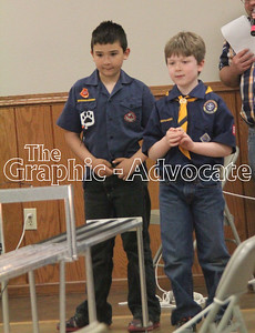 Sam Cardwell and Evan Streufert watch as their Pinewood Derby cars come down the racetrack Sunday afternoon. GRAPHIC-ADVOCATE PHOTO/ERIN SOMMERS
