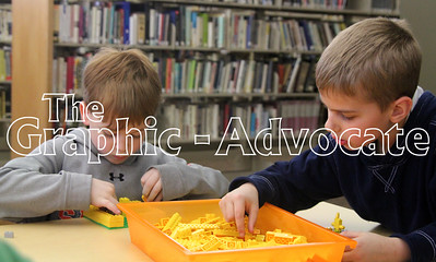 Bayley Schoonover, left, and Bryce Hosek, right, use yellow blocks during a monochromatic LEGO challenge March 30 at the Rockwell City Public Library. GRAPHIC-ADVOCATE PHOTO/ERIN SOMMERS
