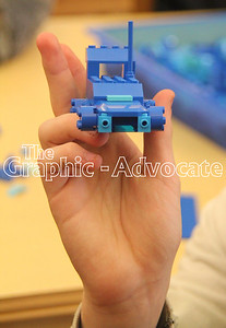 A LEGO Club attendee holds up a completed blue car during the inaugural meeting of the Rockwell City group March 30. GRAPHIC-ADVOCATE PHOTO/ERIN SOMMERS